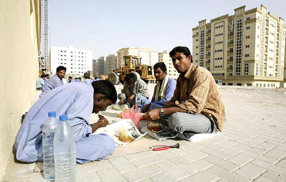 A group of Indian workers take break from work to share their meals.