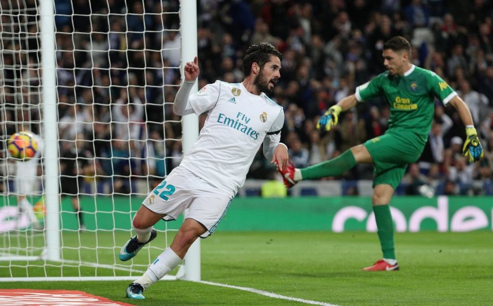 Real Madrid's Isco celebrates scoring their third goal against Las Palmas at Santiago Bernabeu, Madrid, on Sunday. — Reuters