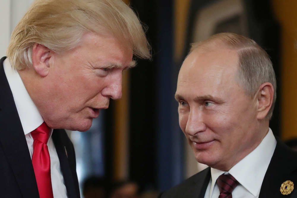 US President Donald Trump (L) chats with Russia's President Vladimir Putin as they attend the APEC Economic Leaders' Meeting, part of the Asia-Pacific Economic Cooperation (APEC) leaders' summit in the central Vietnamese city of Danang on Saturday. — AFP