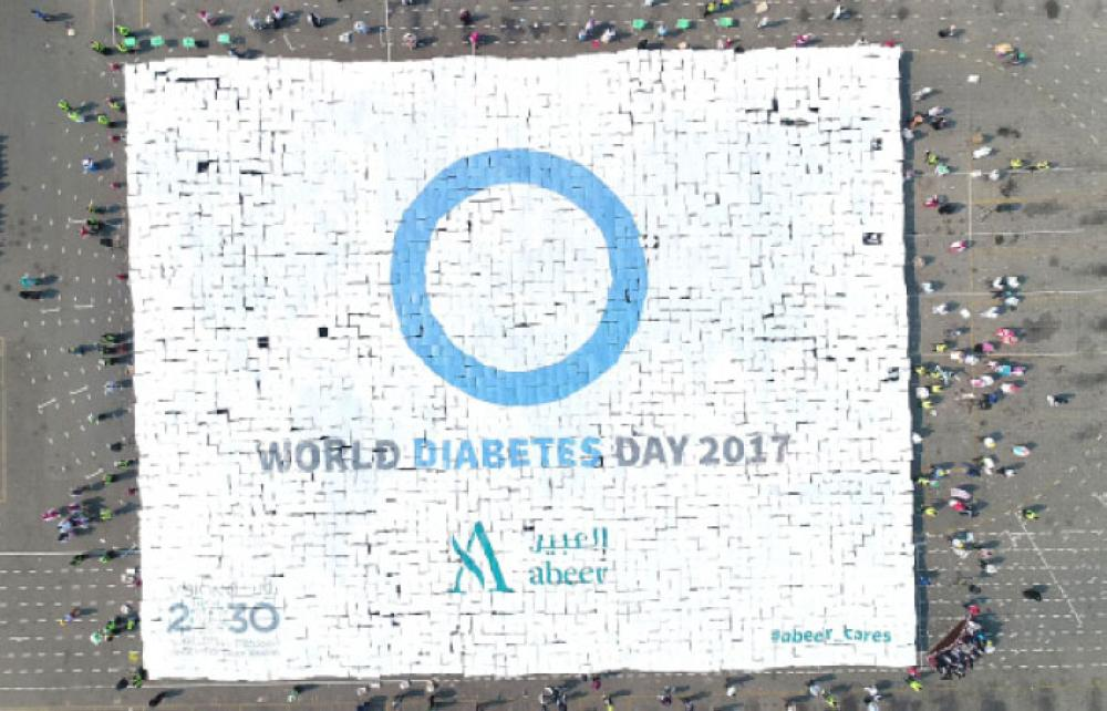 Some 4,500 students take part in forming the largest human mosaic to create aware about diabetes. — Courtesy photo