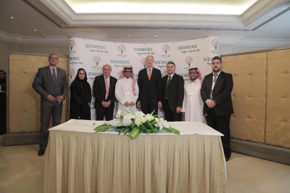Bader Al-Asaker, secrertary general of Misk Foundation, with Siemens officials