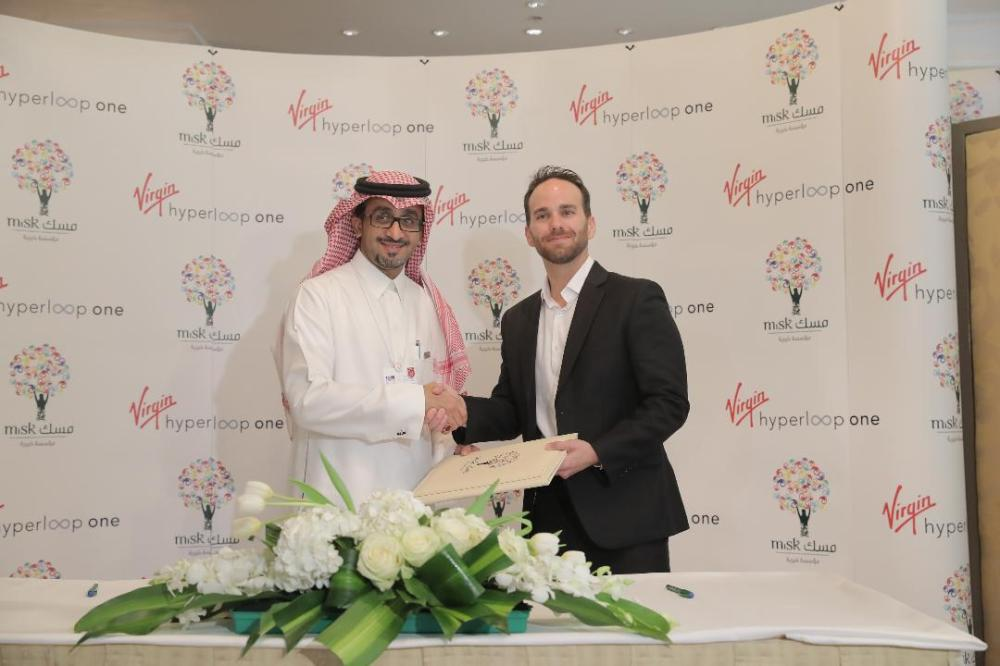 Bader Al-Asaker, secrertary general of Misk Foundation, and Virgin Hyperloop One's co-founder and CTO Josh Giegel, exchange documents after signing an MoU in Riyadh, Thursday. — Courtesy photos
