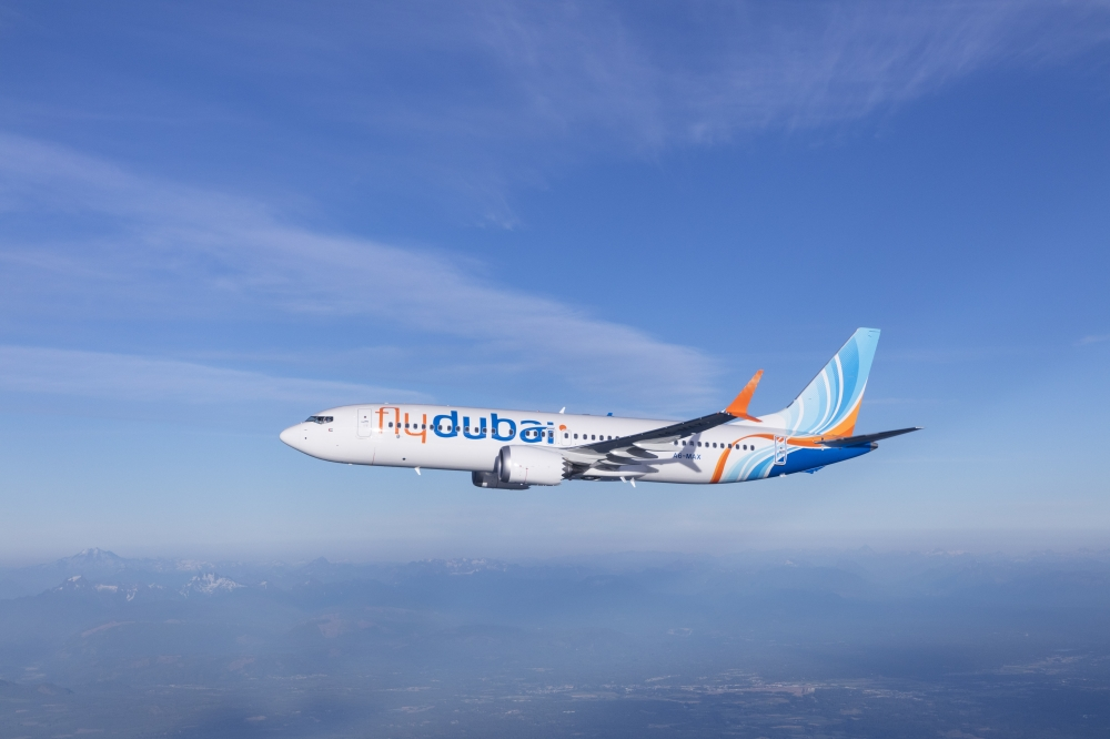 Flydubai Boeing 737 MAX 8 photographed from Wolfe Air Aviation's Learjet 25B.