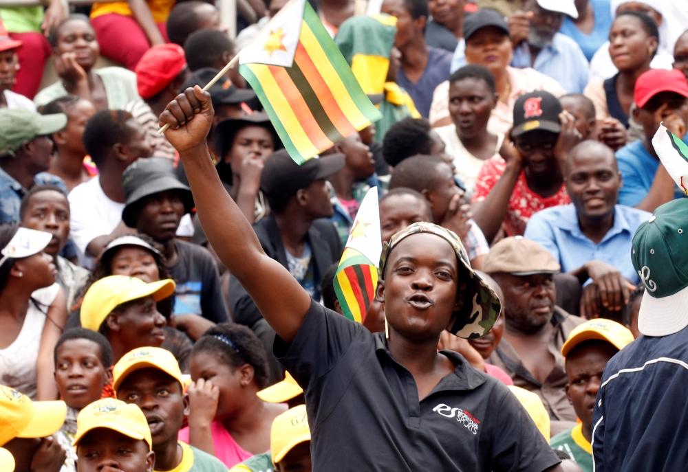 People cheer asMnangagwa is sworn in as president in Harare. — Reuters