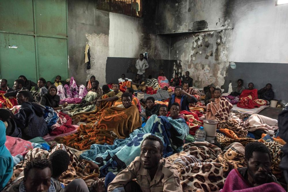 African migrants packed into the Tariq Al-Matar detention center on the outskirts of Tripoli, Libya. — AFP