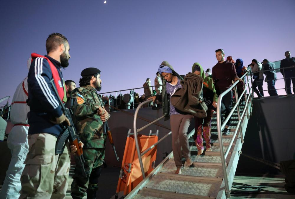 Migrants arriving at a naval base in Tripoli after they were picked up by the Libyan coast guard in November. — Reuters