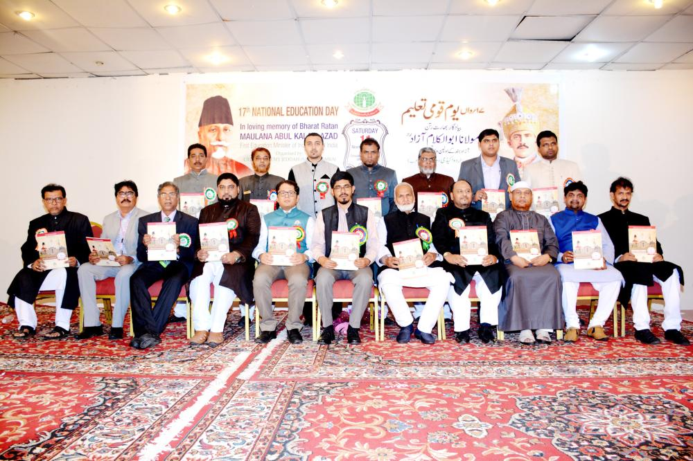"Consul General and members of Urdu Academy holding ""Azad Souvenir 2017"" after its launching"
