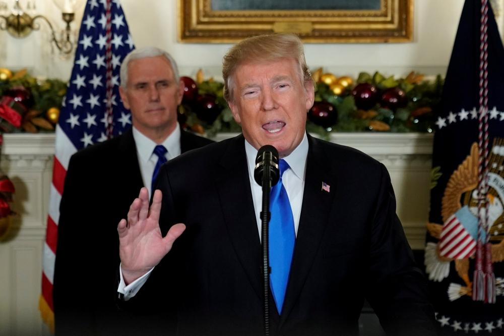 US President Donald Trump, flanked by ‪Vice President Mike Pence‬, delivers remarks recognizing Jerusalem as the capital of Israel at the White House in Washington, US on Wednesday.  — Reuters
