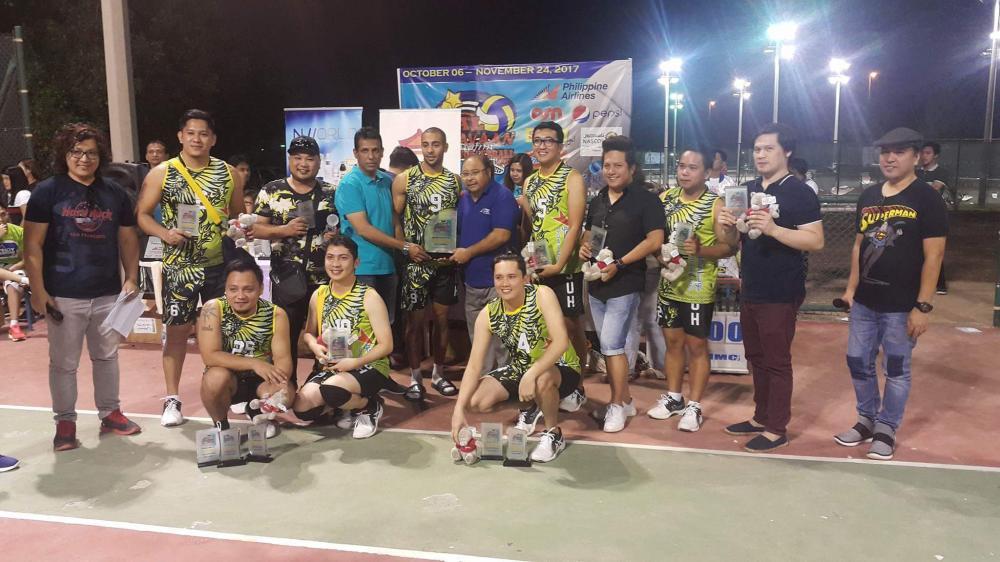 Men's division champion Jeddah United Hitters-UGAFCO pose with the team and individual trophies.