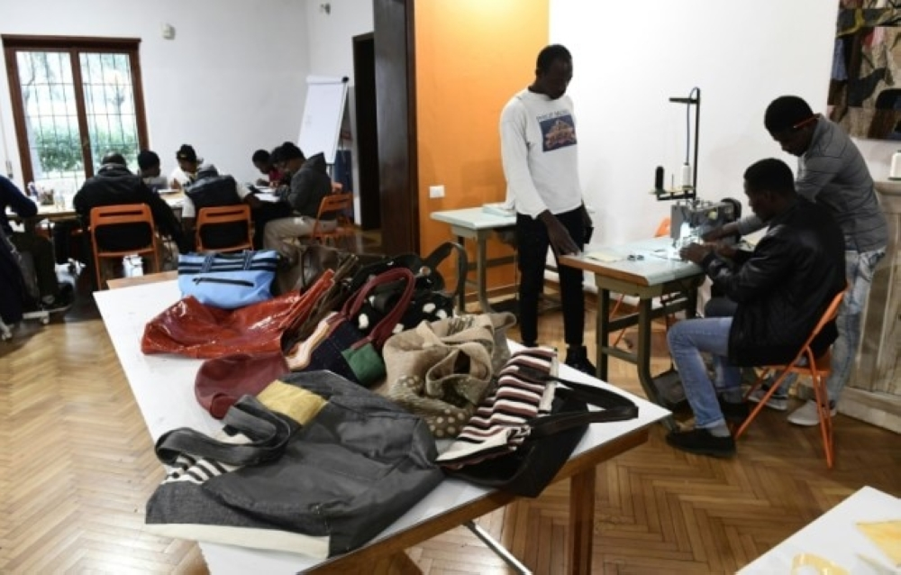Handbags made by migrants at the Lai-Momo headquarters, a vocational training program to teach skills in leather bag making to those seeking asylum in Italy. — AFP photos