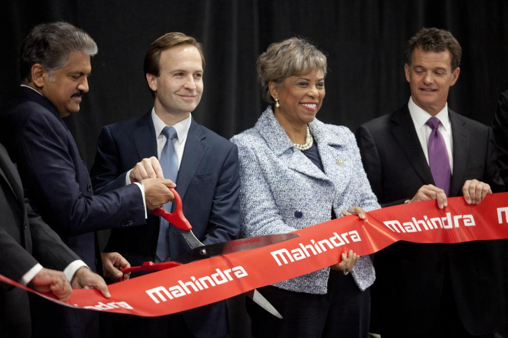 Anand Mahindra, chairman of Mahindra & Mahindra Ltd. (left) cuts the ribbon at the grand opening of the Detroit facility. He's joined by Michigan's Lt. Gov. Brian Calley (second from left) and US Representatives Brenda Lawrence (second from right) and Dave Trott (right).
