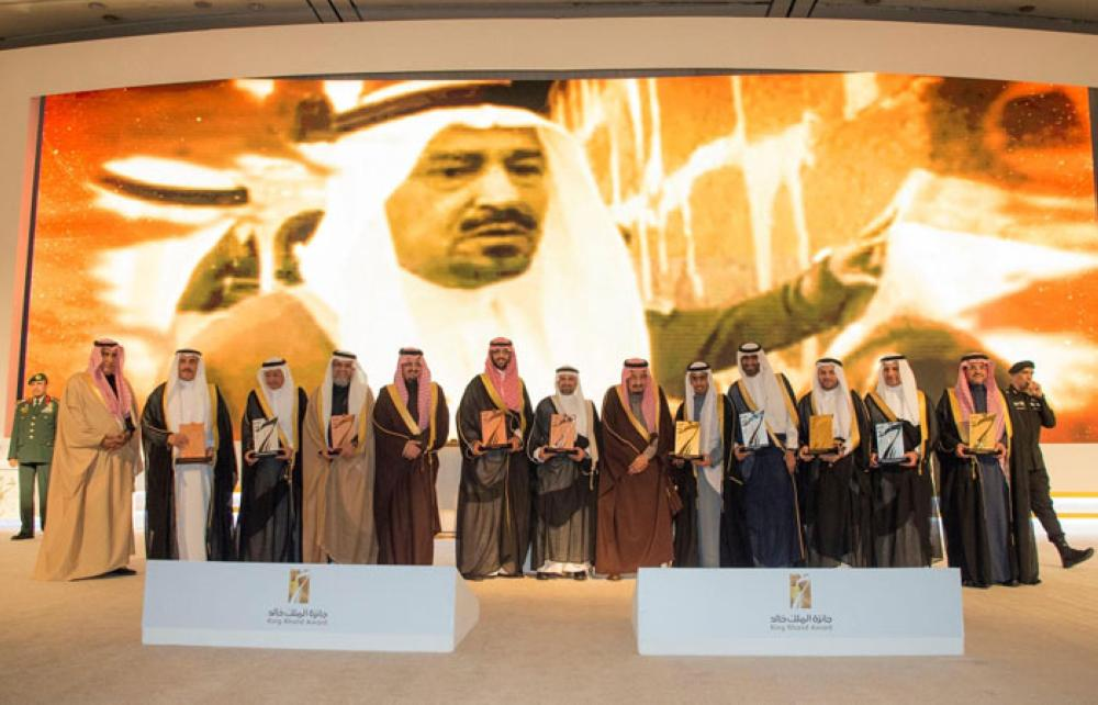 Custodian of the Two Holy Mosques King Salman poses for a group photo with winners of King Khalid Award in Riyadh on Monday evening. — SPA