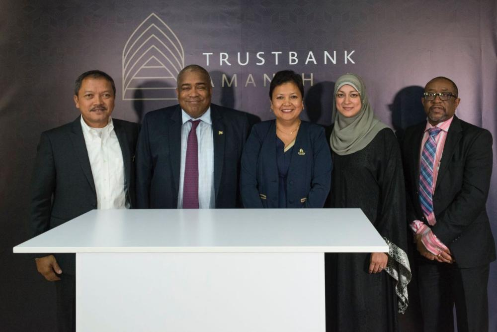 ICD and Trustbank Amanah officials at the opening ceremony of Trustbank Amanah in Suriname. — Courtesy photo