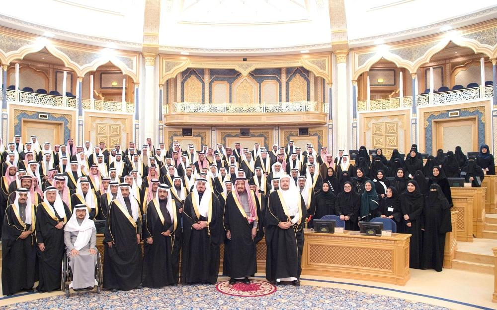 Custodian of the Two Holy Mosques King Salman (2nd right) poses for a group photo with members of the Shoura Council before inaugurating the second year of the 7th session in Riyadh on Wednesday. — SPA