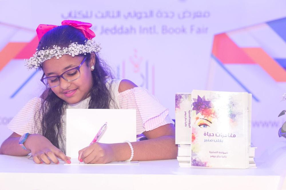 Youngest writer displays published work at book fair