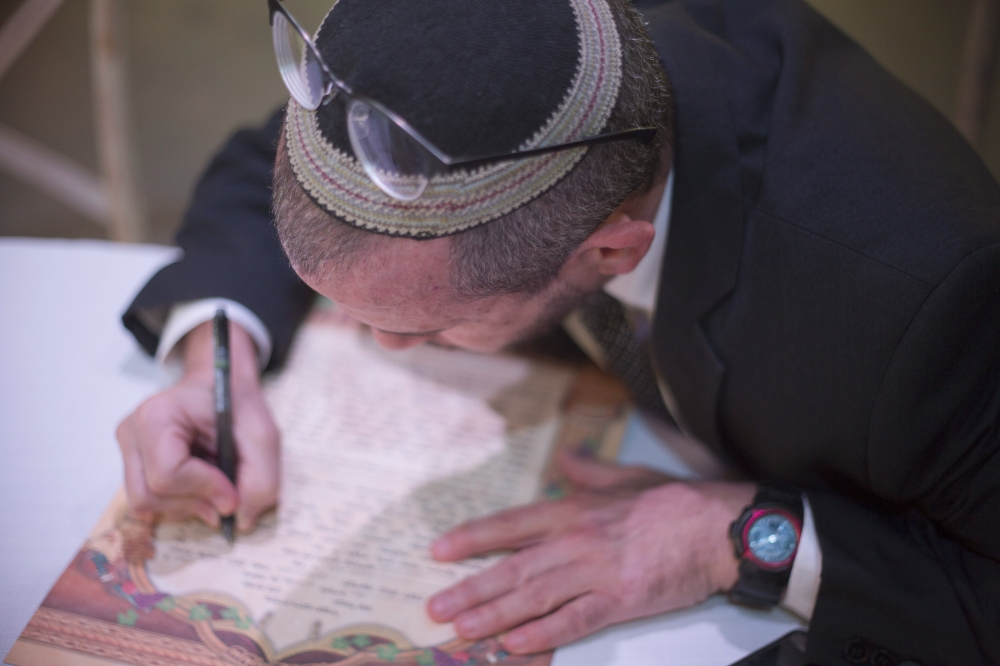 Rabbi Chuck Davidson signs a