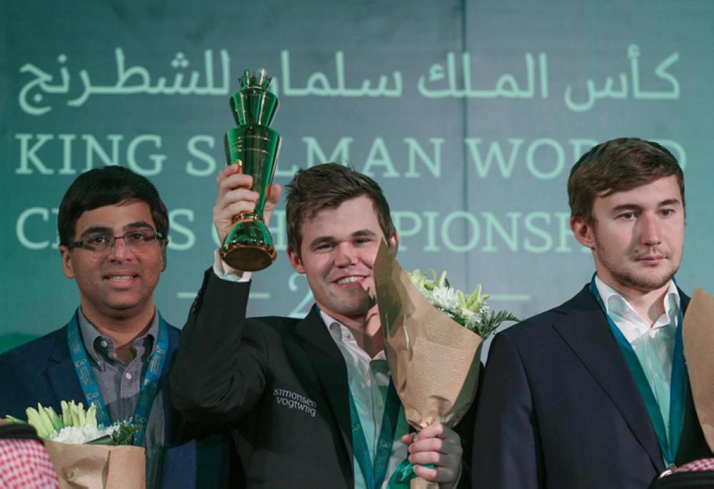 The King Salman World Blitz Champions (men): Magnus Carlsen (center), Sergey Karjakin (right) and World Rapid Champion Viswanathan Anand. — SPA