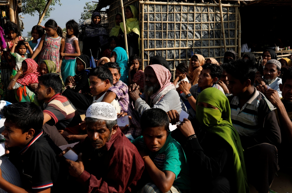 Rohingya refugees wait in line for aid at Kutupalong refugee camp, near Cox's Bazar, Bangladesh, on Thursday. — Reuters