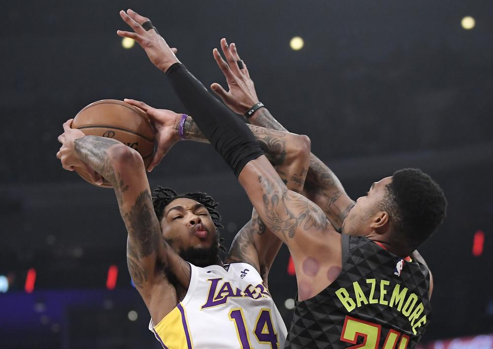 Los Angeles Lakers' forward Brandon Ingram shoots as Atlanta Hawks' guard Kent Bazemore defends during their NBA game in Los Angeles Sunday. — AP