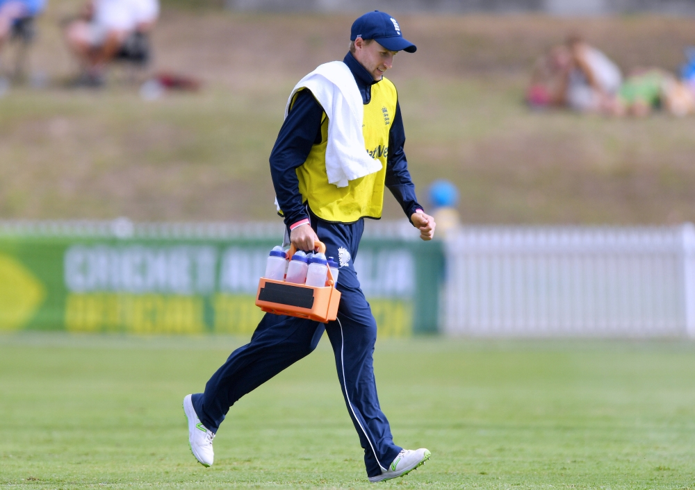 England's Joe Root runs off the pitch carrying water bottles during a limited overs tour match against a Cricket Australia XI team at Drummoyne Oval in Sydney, Australia, on Thursday. — AP
