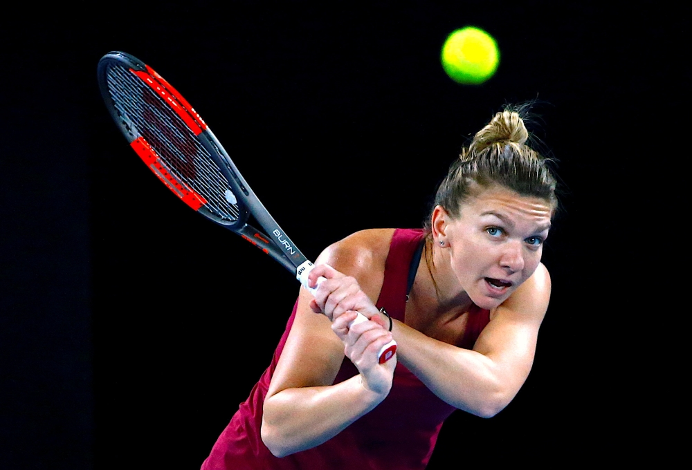 Simona Halep faces nervous wait over ankle injury