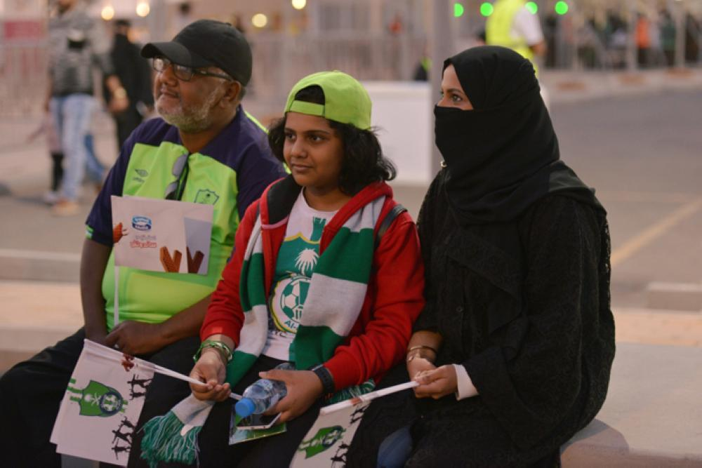 A Saudi family arrives to watch the soccer match between Al-Ahli against Al-Batin at the King Abdullah Sports City in Jeddah, Saudi Arabia on Friday. — Reuters