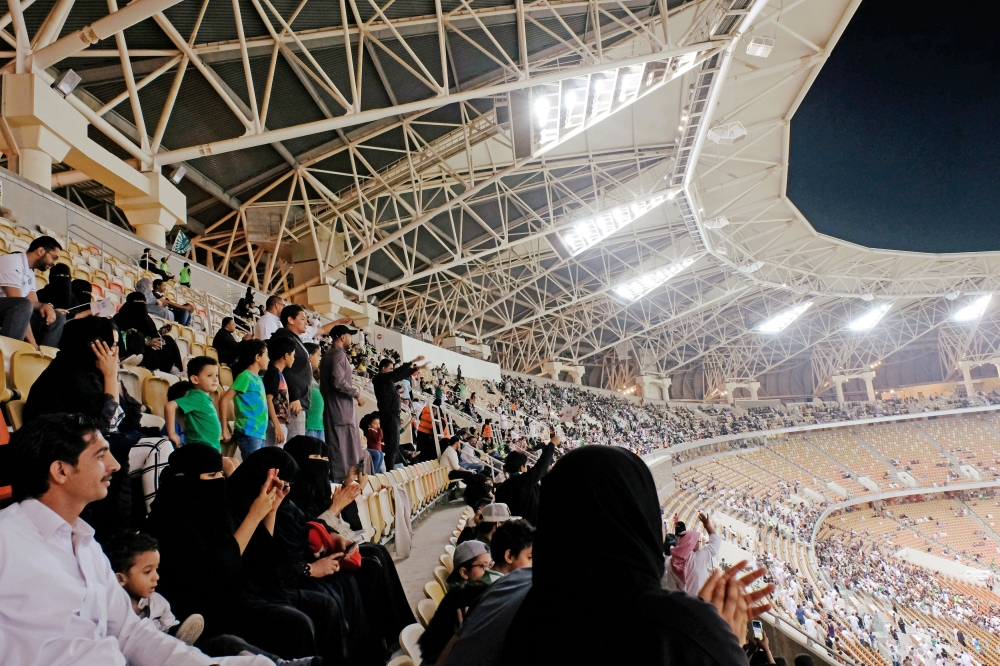 Saudi women arrive to watch the soccer match between Al- Hilal club against Al Ittihad club at the King Fahd stadium in Riyadh, Saudi Arabia Saturday. — Reuters
