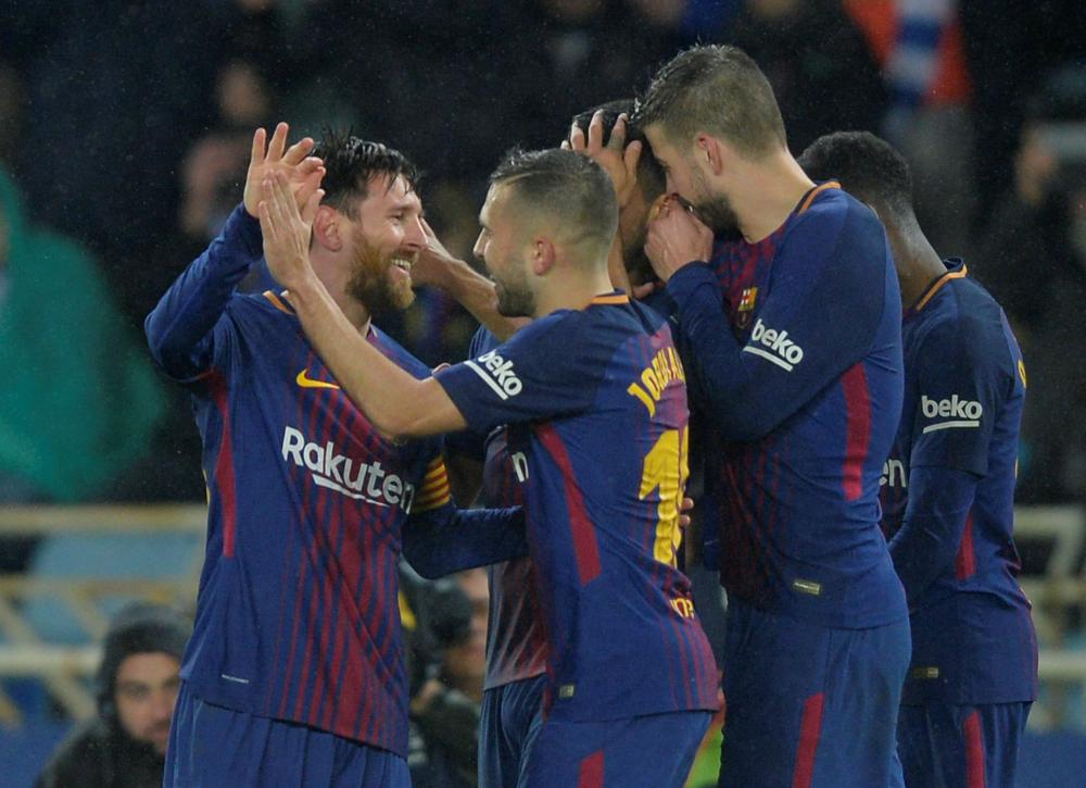 Suarez fires Barcelona nine clear in Sociedad fightback