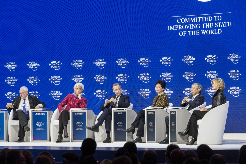 """(From left to right) Martin Wolf, Associate Editor and Chief Economics Commentator, Financial Times; Christine Lagarde, Managing Director, International Monetary Fund (IMF); Member of the Board of Trustees, World Economic Forum, Mark Carney, Governor of the Bank of England; Member of the Board of Trustees, World Economic Forum, Carrie Lam, Chief Executive of Hong Kong SAR, Haruhiko Kuroda, Governor of the Bank of Japan and Mary Callahan Erdoes, Chief Executive Officer, Asset and Wealth Management, JPMorgan Chase & Co., USA during the Session """"Global Economic Outlook"""" at the World Economic Forum in Davos on Friday. — Courtesy: WEF/Benedikt von Loebell"""