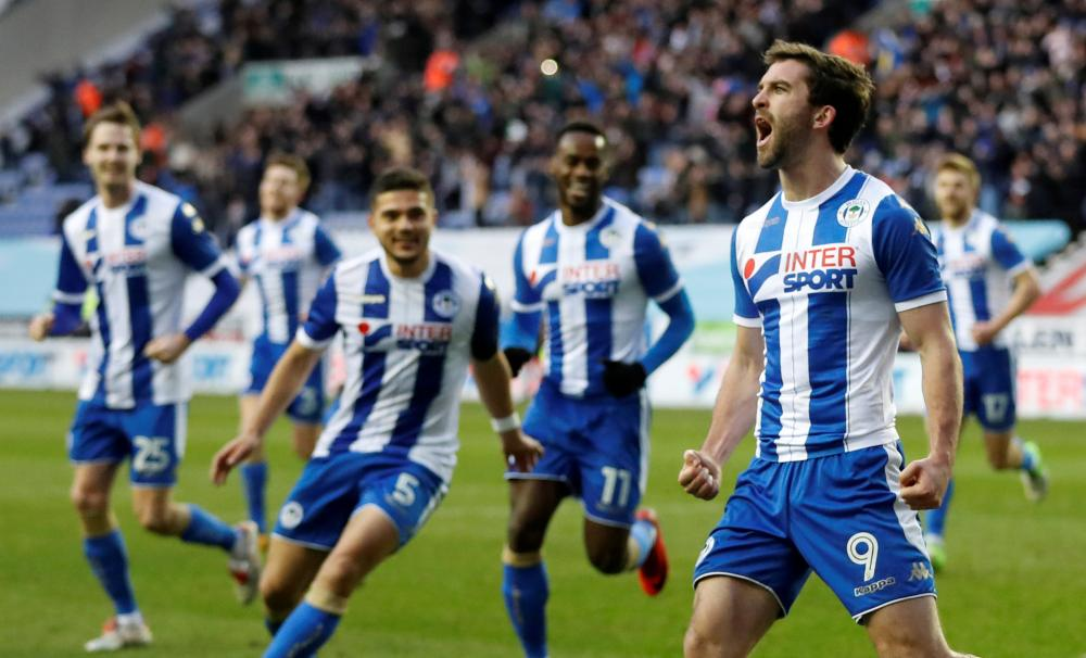 Wigan Athletic's Will Grigg celebrates scoring their second goal against West Ham during their FA Cup match DW Stadium, Wigan, Saturday. — Reuters