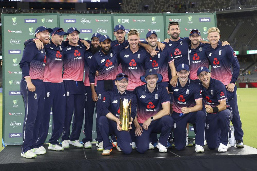 The England team poses after clinching the ODI series in Perth Sunday. — AP