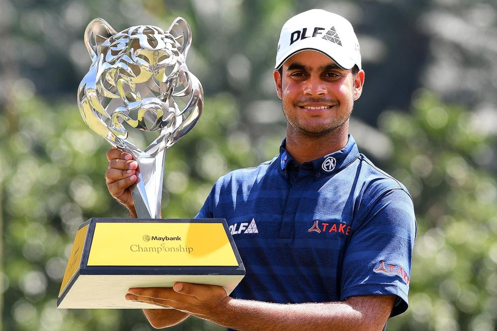 Sharma clinches title to take Race to Dubai lead