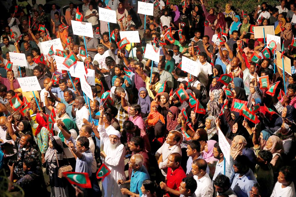 Opposition supporters protest against the government's delay in releasing their jailed leaders, including former President Mohamed Nasheed, despite a Supreme Court order, in Male, on Sunday. — Reuters