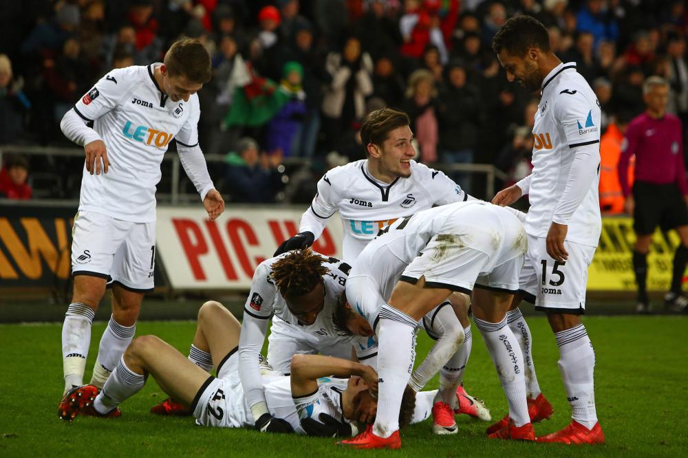 Swansea score eight to win FA Cup replay; Huddersfield escape