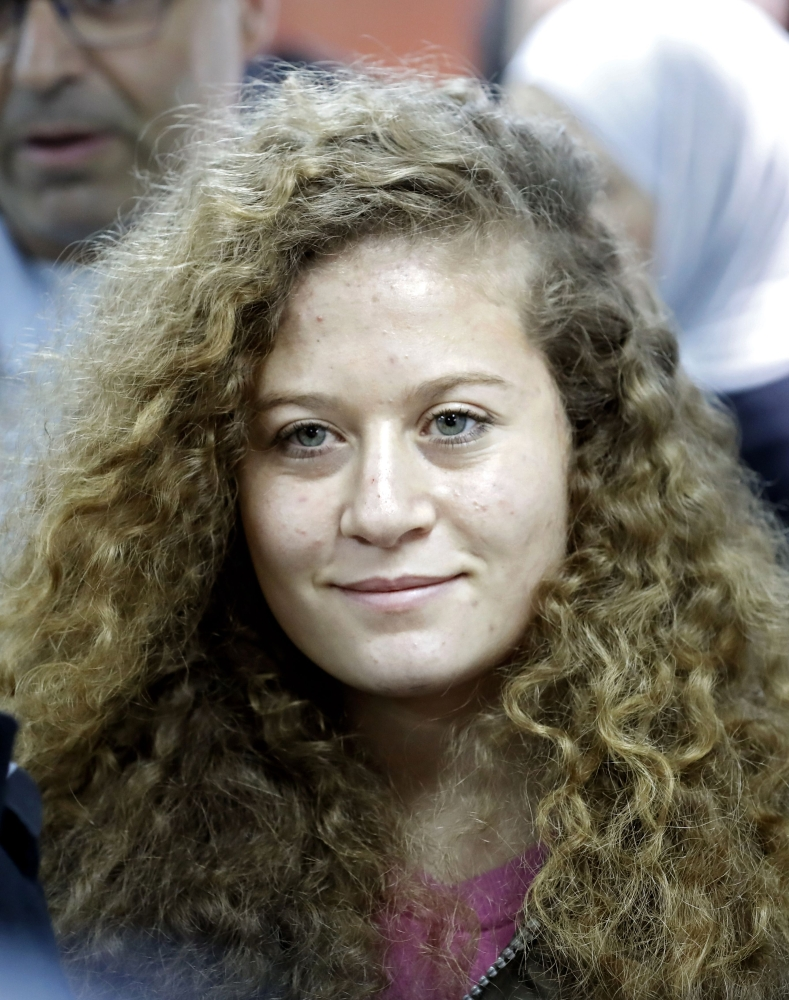 Palestinian Ahed Tamimi, 17, a well-known campaigner against Israel's occupation, arrives for the beginning of her trial in the Israeli military court at Ofer military prison in the West Bank village of Betunia on Tuesday.  — AFP