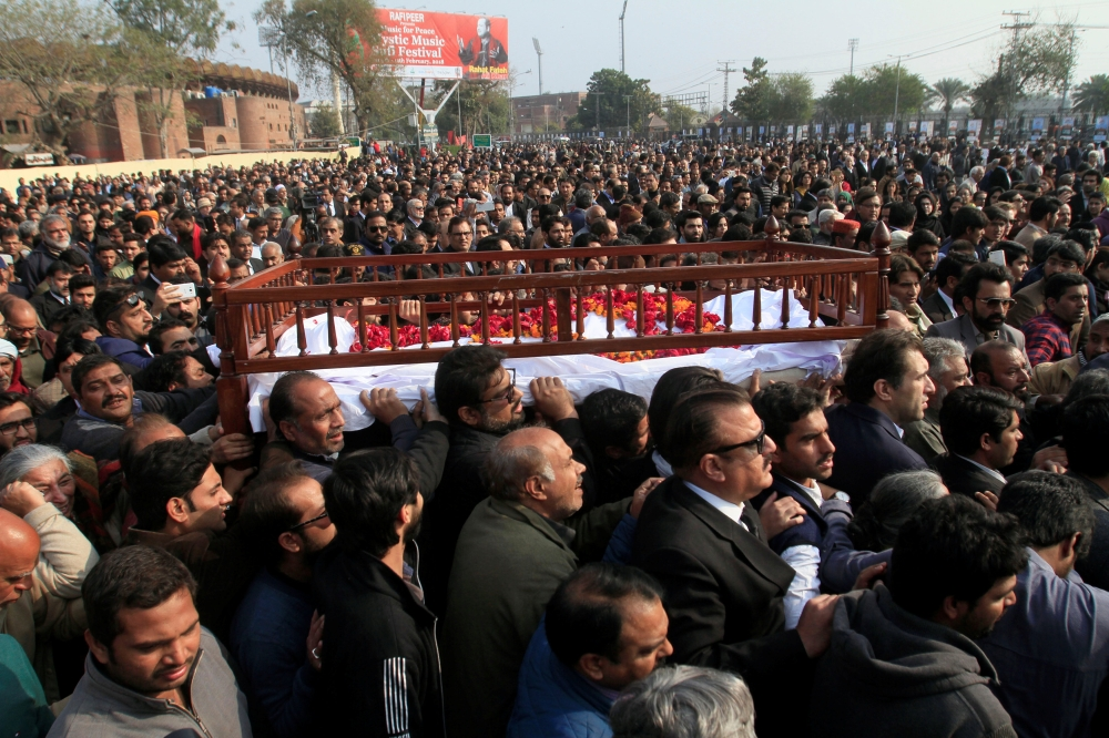 People carry the coffin of human rights campaigner Asma Jahangir who died on Sunday during her funeral in Lahore Pakistan on Tuesday. — Reuters