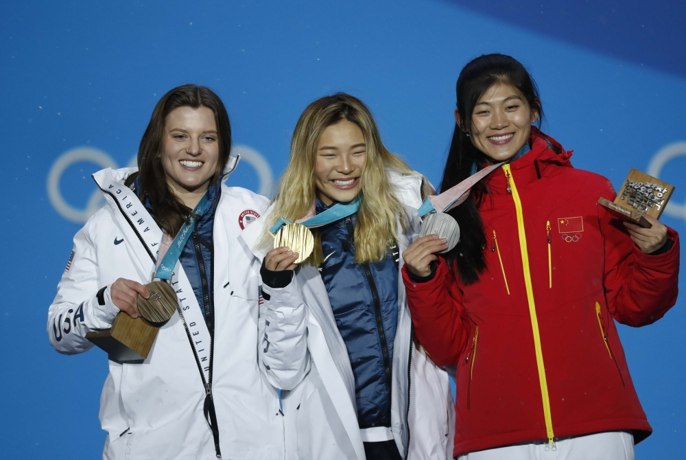 Gold medalist Chloe Kim of the US, silver medalist Liu Jiayu of China and bronze medalist Arielle Gold of the US on the podium after the Women's Halfpipe in Snowboarding at the Pyeongchang 2018 Winter Olympics on Tuesday. — Reuters