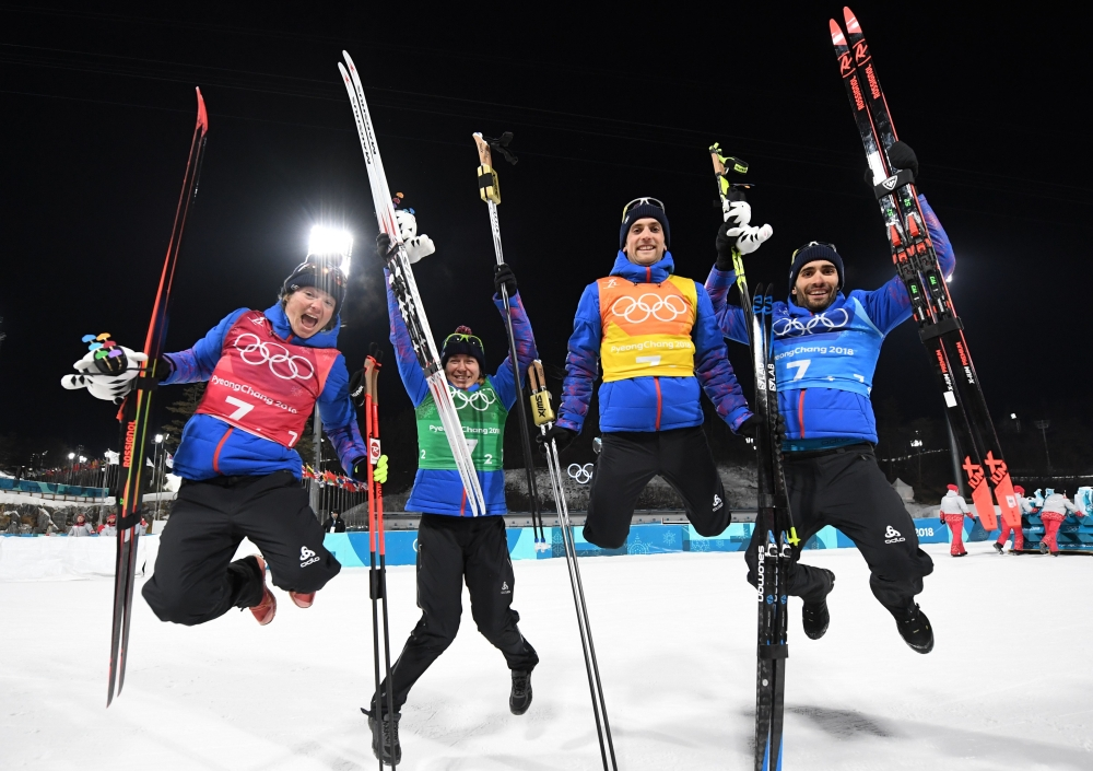 (From L) Gold medalists France's Marie Dorin Habert, Anais Bescond, Simon Desthieux, and  Martin Fourcade celebrate during the victory ceremony in the mixed relay biathlon event during the Pyeongchang 2018 Winter Olympic Games on Tuesday in Pyeongchang. — AFP