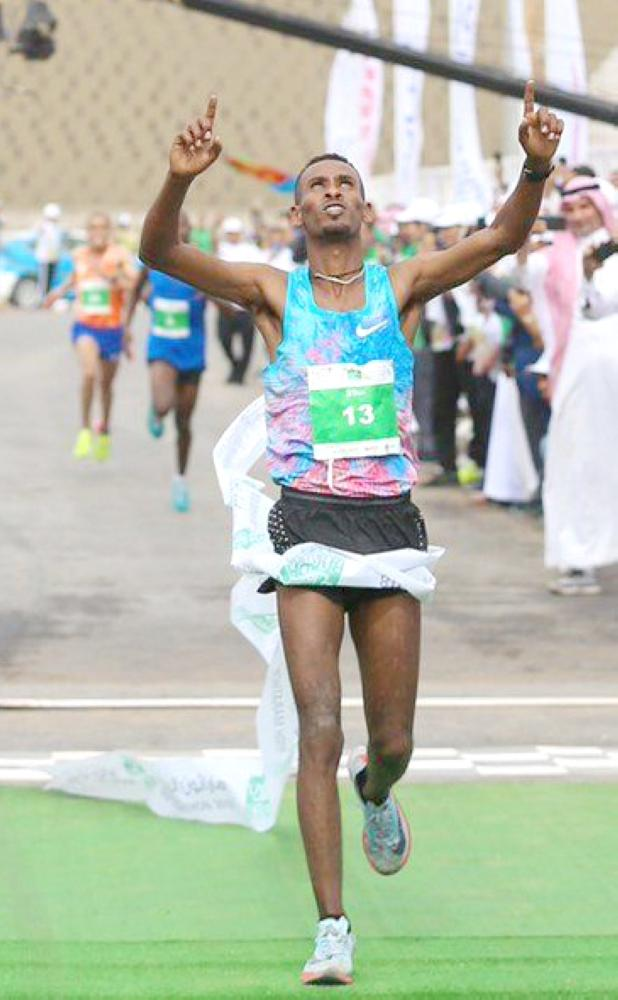 Ethiopian runner Tamire Molla celebrates after winning the first position in the 21-km professional category race at the first Riyadh International Half Marathon on Saturday.