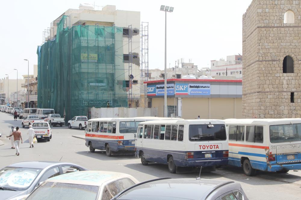 Minibuses that were put out of service remain parked in downtown Jeddah.