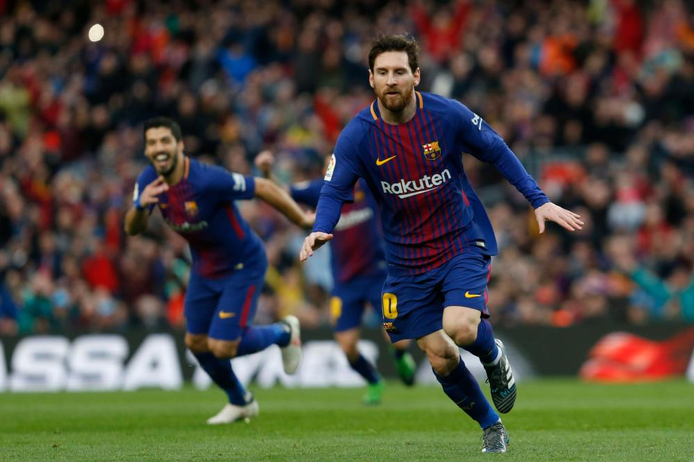 Barca pull clear as Messi brilliance edges out Atletico