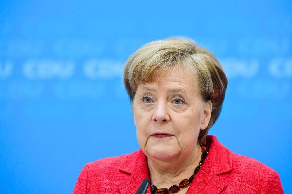 Germany's Social Democrats sign up for Merkel's grand coalition