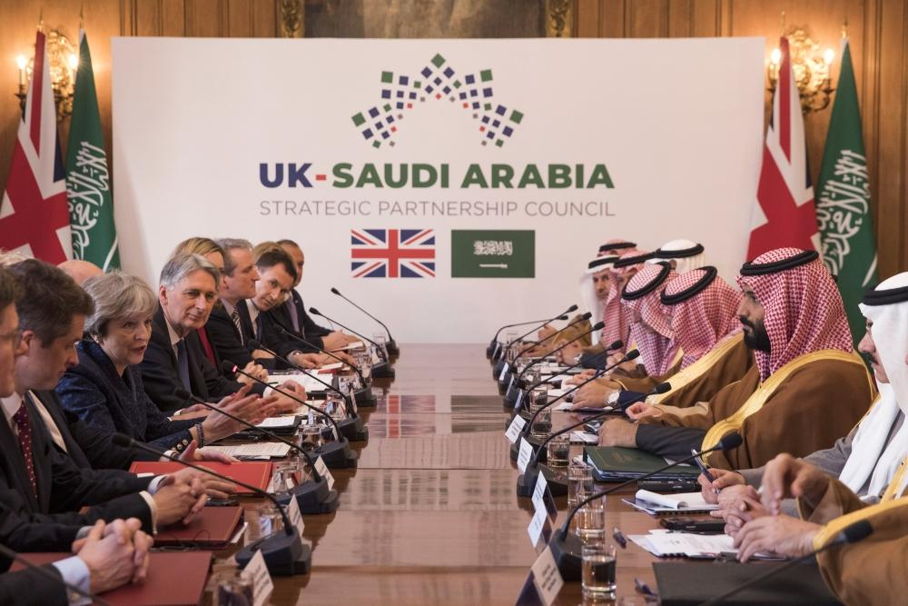 British Prime Minister Theresa May and Crown Prince Muhammad Bin Salman hold a meeting with other members of the British government and Saudi ministers and delegates inside number 10 Downing Street in London on Wednesday. — Reuters