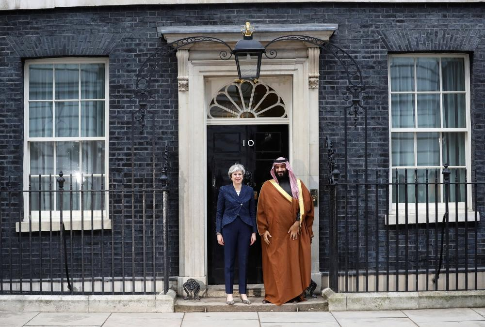 Britain's Prime Minister Theresa May greets Crown Prince Muhammad Bin Salman outside 10 Downing Street in London on Wednesday. — Reuters
