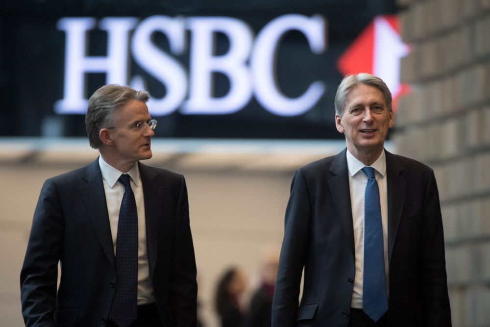 Britain's Finance Minister Philip Hammond, with CEO John Flint, arrives at HSBC to deliver a speech on Brexit at their headquarters in Canary Wharf in London, Britain. — Reuters