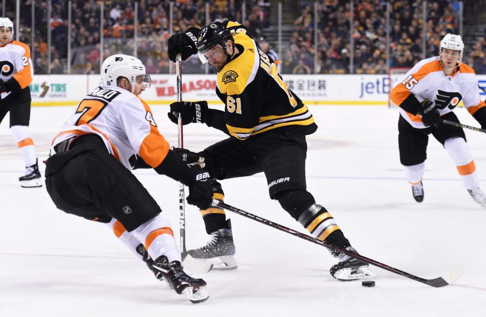 Marchand's last-minute goal leads Bruins past Flyers