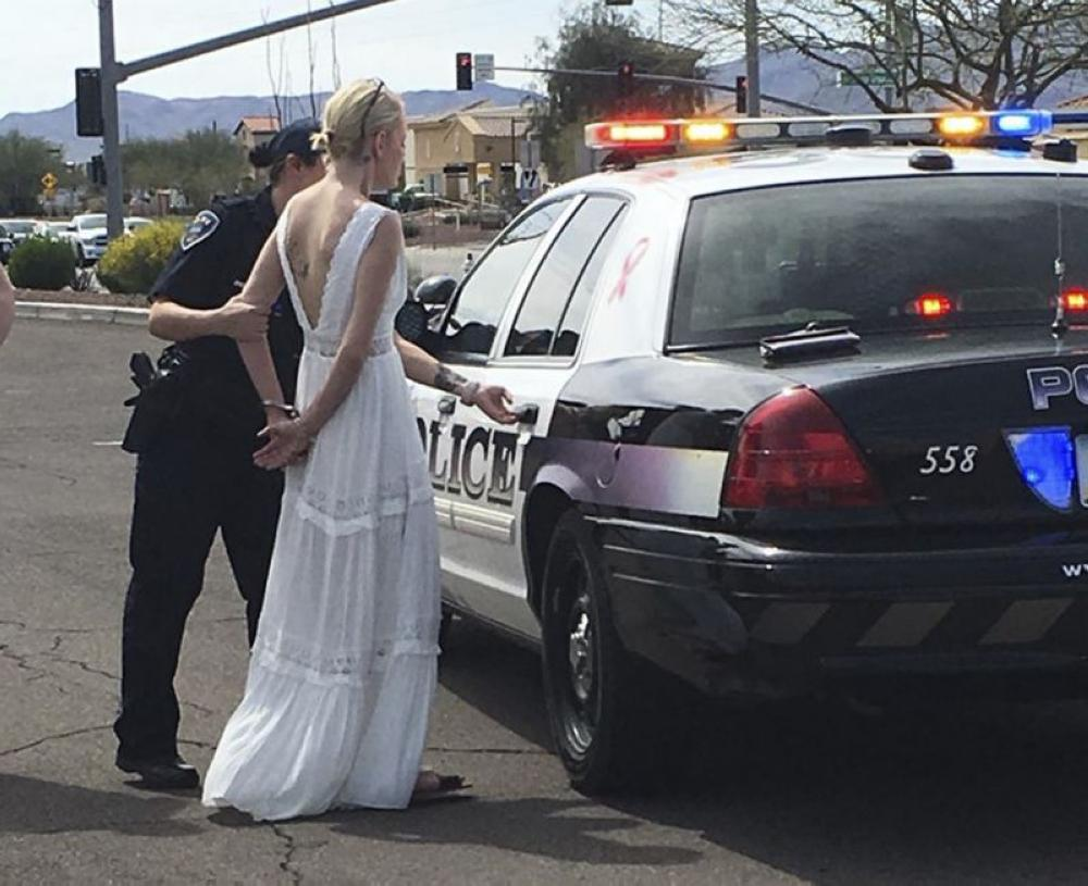 This photo provided by the Marana Police Department, in Arizona, shows 32-year-old Amber Young during her arrest on suspicion of impaired driving, on Monday, in southern Arizona. - AP