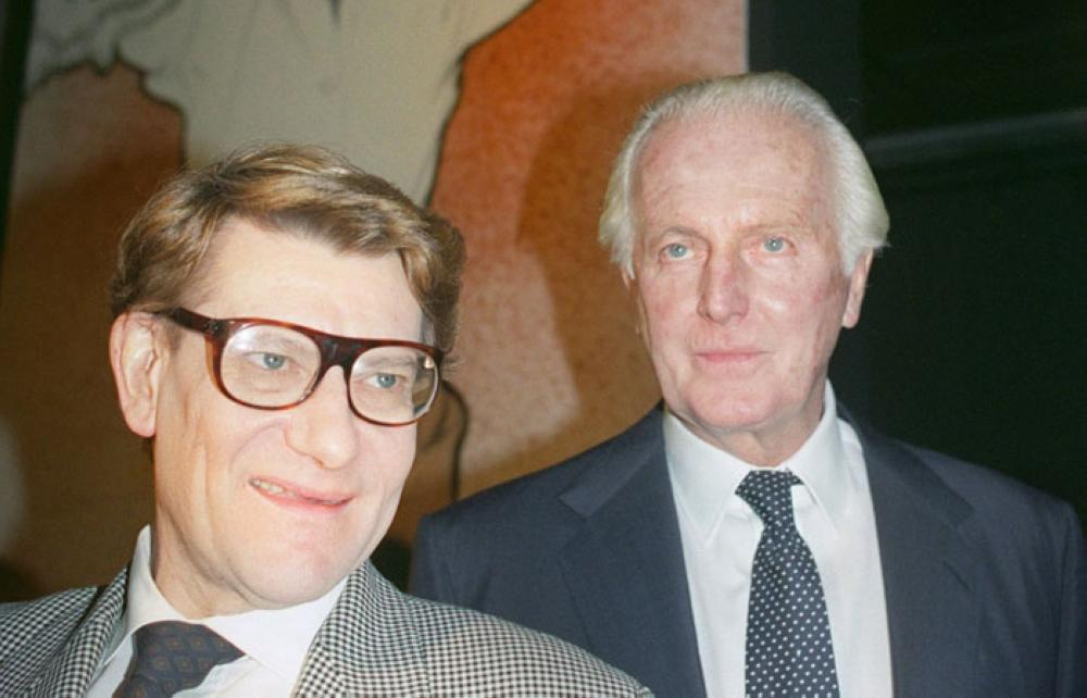 In this file photo taken on October 21, 1991, French designers Yves Saint-Laurent and Hubert de Givenchy, right, pose together in the Galliera Museum during a reception honoring Givenchy for his 40 years in fashion. - AFP