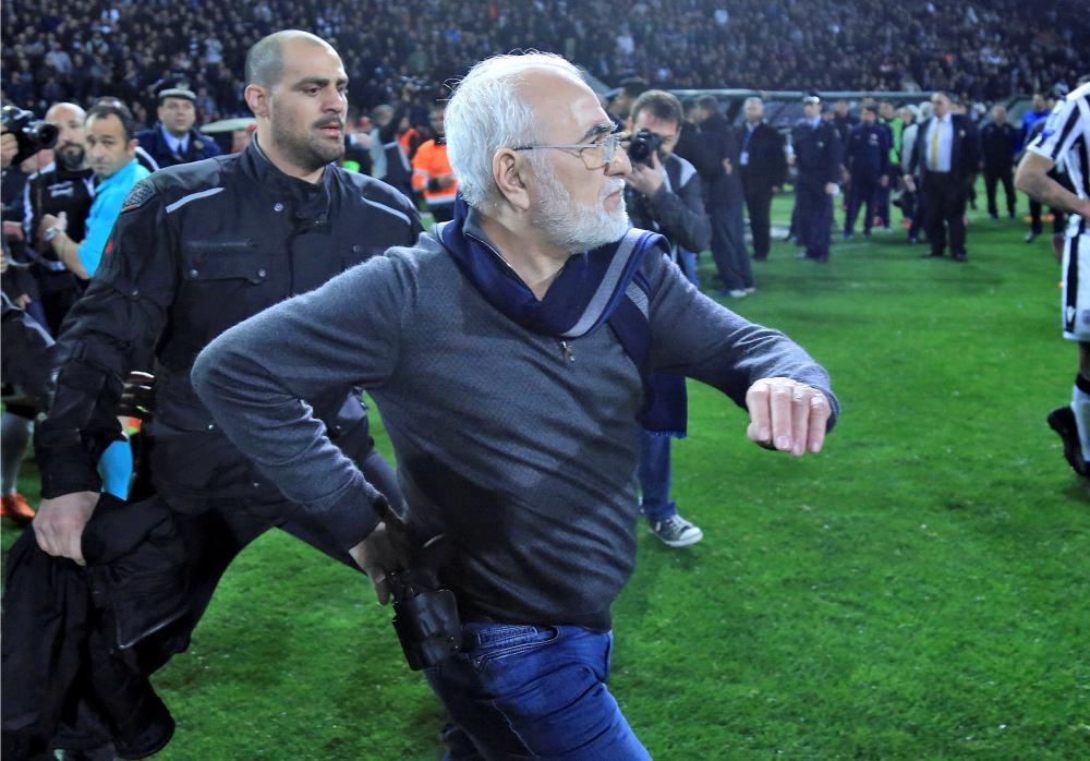 PAOK owner apologises after invading pitch with gun