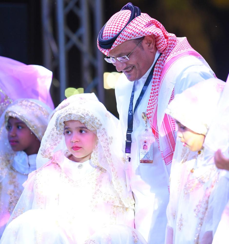 Saleh Abdullah Zahrani, chairman of the festival committee, speaks with children at the show.